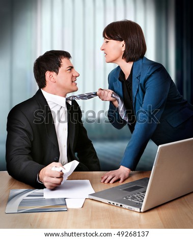 businesswoman and businessman are fighting - stock photo