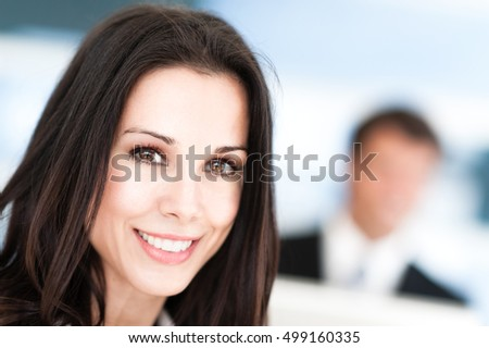 Businesswoman and Businessman in Office