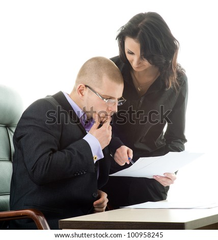 Businesswoman and businessman signing contracts in an office, isolated on white