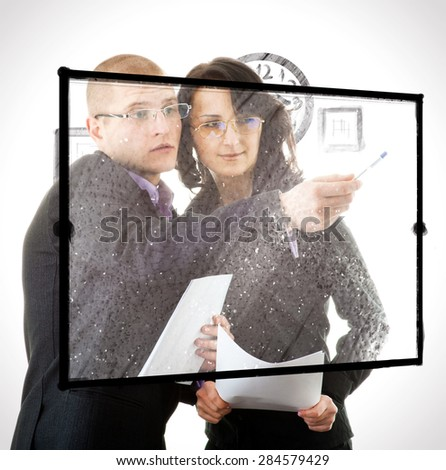 Businesswoman and businessman signing contracts in an office, isolated on white - stock photo