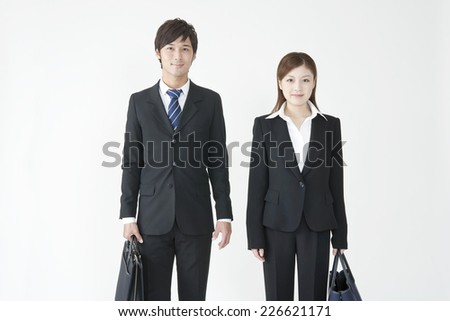 Businesswoman and businessman standing side by side - stock photo