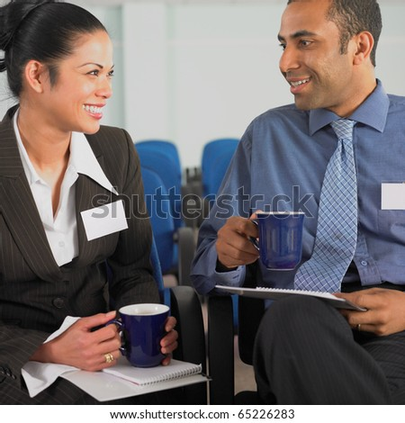 Businesswoman and businessman talking - stock photo