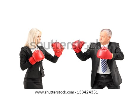 Businesswoman and businessman with boxing gloves having a fight isolated on white background - stock photo