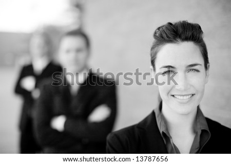 businesswoman and businessmen wearing formal wear standing in line smiling - stock photo