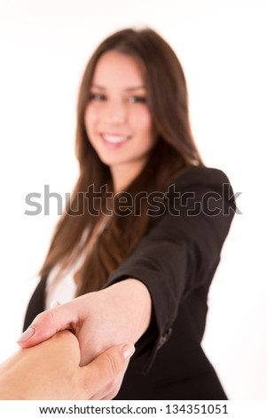 Businesswoman and client handshaking - selective focus on hand - stock photo