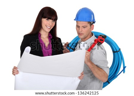 businesswoman and craftsman - stock photo
