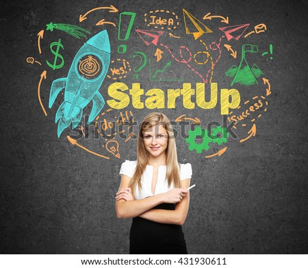 businesswoman and drawing Start up concept on concrete wall - stock photo