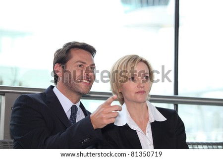 Businesswoman and man pointing - stock photo