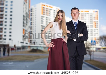 Businesswoman and man stands on the street in the city