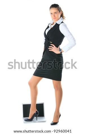 Businesswoman and the laptop. Isolated on white. - stock photo