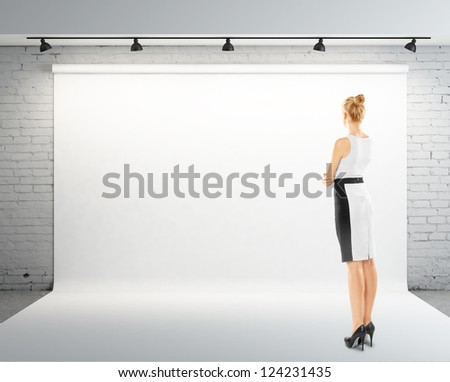 businesswoman and white backdrop on wall - stock photo