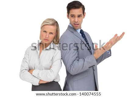 Businesswoman angry against her colleague arguing on white background - stock photo