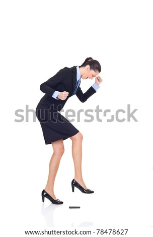 businesswoman angry on her cellphone, smashing phone with leg, isolated on white background concept, - stock photo