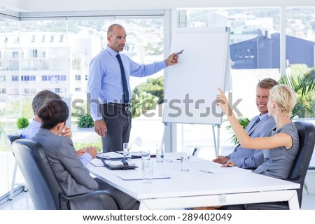 Businesswoman asking question during meeting in the office - stock photo