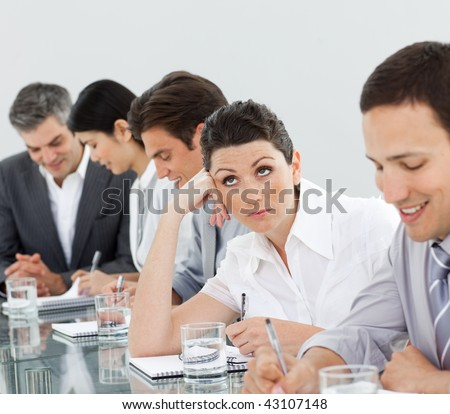 Businesswoman at a presentation with her colleagues - stock photo