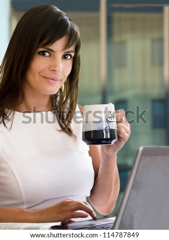 businesswoman at coffee break against business building