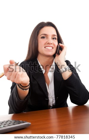 Businesswoman at her desk - stock photo