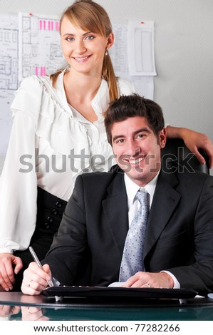 businesswoman at office with her boss in chair