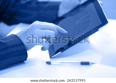 Businesswoman at office working with digital PC - stock photo