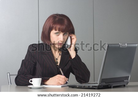 businesswoman at the office - stock photo