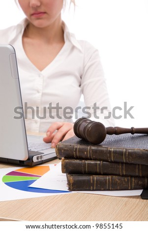 businesswoman at the office with her laptop and gavel