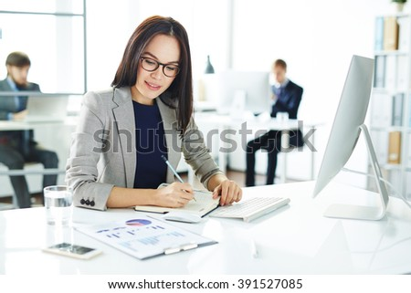 Businesswoman at work - stock photo