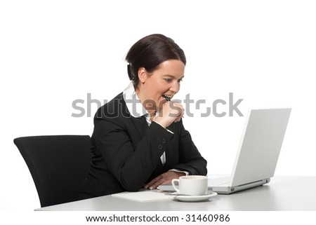Businesswoman at work with laptop