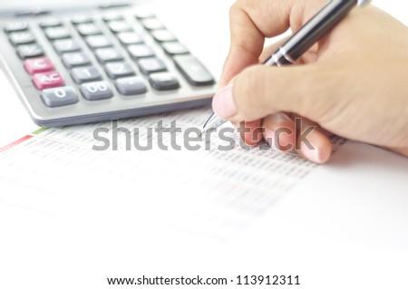 Businesswoman balancing the accounts - stock photo