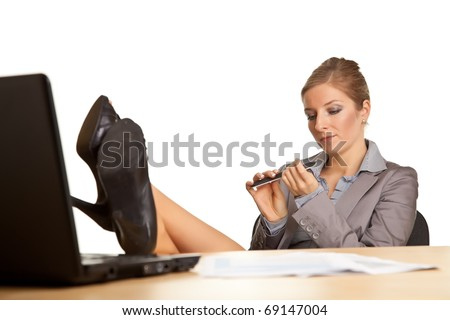 Businesswoman bored in office isolated on white - stock photo