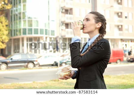 businesswoman breakfast on the way to work, overworked - stock photo