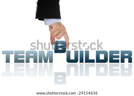 businesswoman building teambuild word with letter blocks - isolated on white background - stock photo