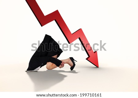 Businesswoman burying her head against red arrow pointing down - stock photo