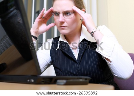 businesswoman - business woman concentrated - concentrative . She wears glasses and did some calculation. - stock photo