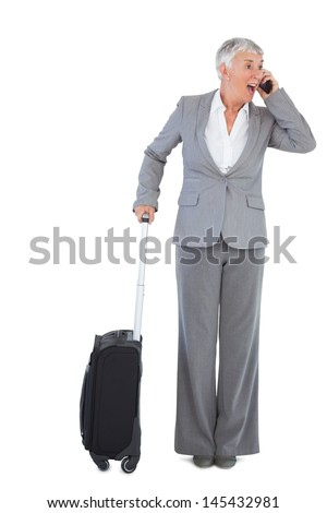 Businesswoman calling and has luggage on white background