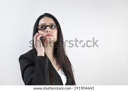 Businesswoman calling on the phone with white background - stock photo
