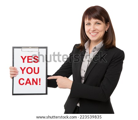 "Businesswoman carrying sign saying ""yes you can"" - stock photo"