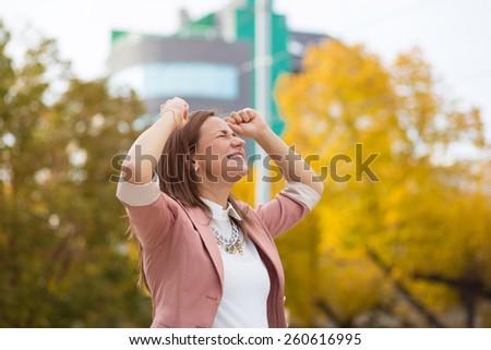 Businesswoman celebrating success - stock photo