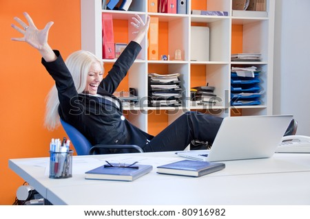 Businesswoman celebrating success in business - stock photo
