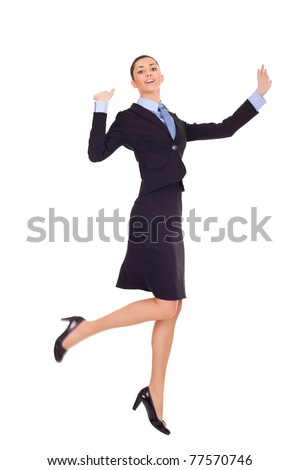 businesswoman celebrating success with jumping and dancing, isolated on white - stock photo