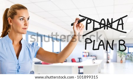 Businesswoman changing her plans on the screen - stock photo