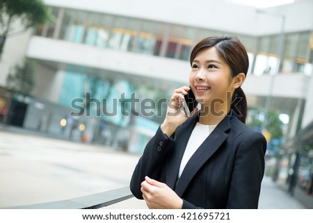 Businesswoman chat on cellphone at outdoor
