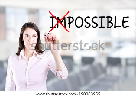 Businesswoman choosing Possible instead of Impossible. Office background. - stock photo