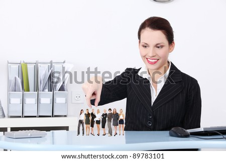 Businesswoman choosing the right worker from group of candidates.