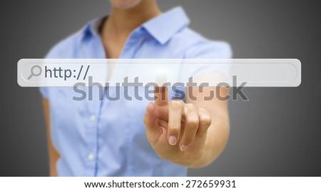 Businesswoman clicking on tactile interface web address bar� - stock photo