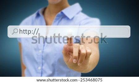 Businesswoman cliking on tactile interface web address bar - stock photo