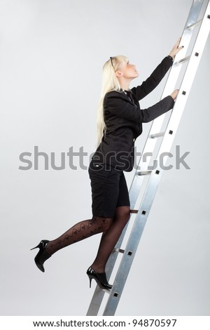 businesswoman climbing the stairs to the top - stock photo
