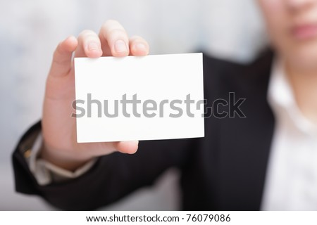 Businesswoman Closeup - presenting her business card