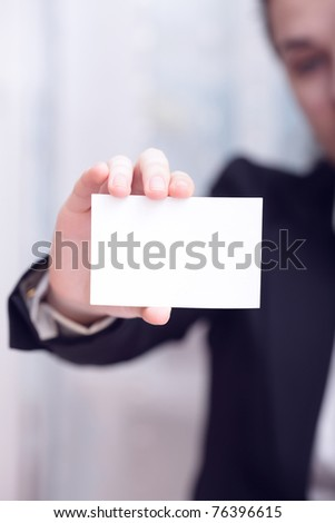 Businesswoman Closeup - presenting her business card - stock photo