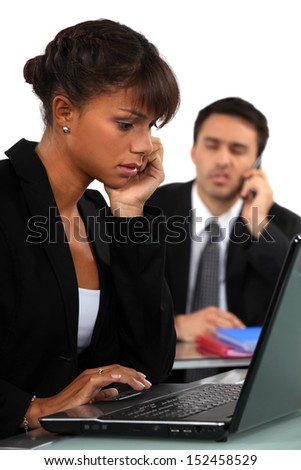 Businesswoman concentrating on her work - stock photo