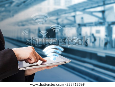 Businesswoman connecting to Wifi